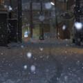 写真: 降雪越しの近所の夕景