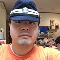 Photos: 大戦日本海軍士官の略帽をかぶる