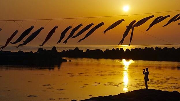夕陽のフォトグラファー