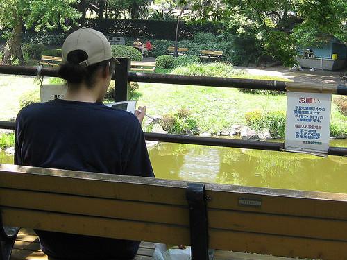 Young man unashamedly smoking at non-smoking area of Hibiya Park